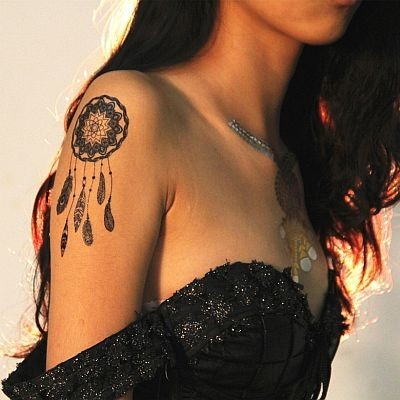 Tatouage dentelle noire, Mikiti